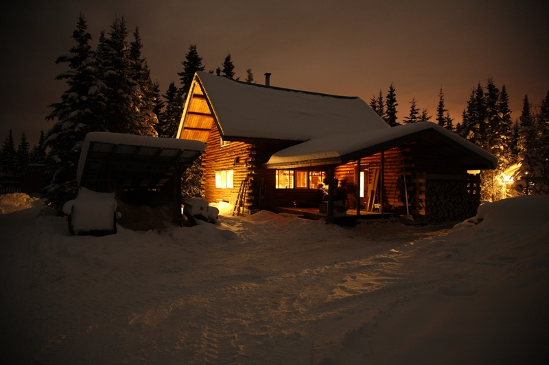 Cabin in Snow at night